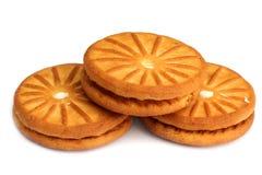 Печенья при изолированная сливк стоковая фотография