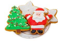 Печенья пряника рождества на белой плите Стоковое Фото