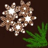 Печенья рождества в форме снежинок на темной деревянной предпосылке Стоковые Изображения RF