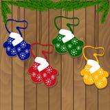 Печенья рождества в форме mitten на деревянной предпосылке Стоковые Фото