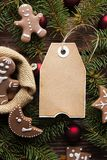 Печенья рождества, елевое дерево и ярлык чистого листа бумаги стоковые фото