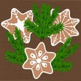 Печенья рождества и ветви рождественской елки Стоковое Изображение