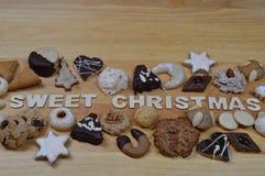 Печенья рождества и СЛАДОСТНОЕ РОЖДЕСТВО Стоковое фото RF