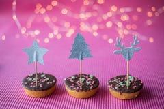 Печенья рождества на розовой предпосылке Стоковое фото RF