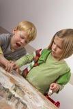 печенья рождества режа малышей 2 Стоковое Фото