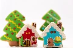 Печенья, рождественские елки и дома пряника рождества Стоковая Фотография