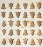 Печенья рождественской елки на деревянной предпосылке Стоковое Изображение