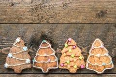 Печенья рождества на деревянной предпосылке с текстовым полем Стоковые Фото
