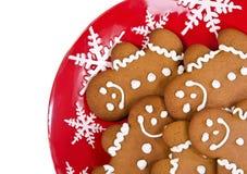 Печенья человека пряника на плите рождества стоковое фото rf