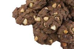 Печенья шоколада макадамии изолированные на белизне Стоковые Фото