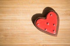 Печенья шоколада с красной и белой поливой Стоковое Изображение