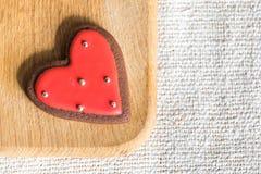 Печенья шоколада с красной и белой поливой Стоковые Изображения RF