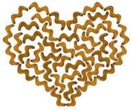 Печенья шутихи в форме зигзага в контуре изолированных сердец Стоковое Фото