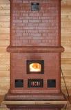 Печь кирпича с огнем в двери печи Стоковое Изображение
