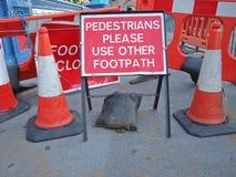 пешеходы к предупреждению Стоковое Изображение
