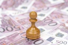 Пешка на деньгах евро стоковые фотографии rf