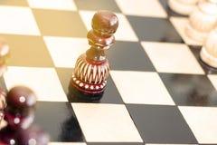 Пешка на шахматной доске стоковая фотография rf