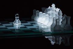Пешка шахмат против всей фары Стоковые Изображения