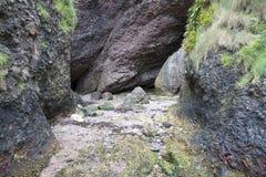 Пещеры Cushendun, графство антрим Стоковые Изображения RF