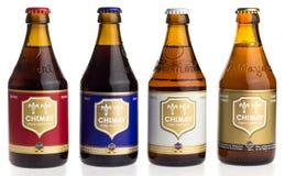 Пиво бутылок Chimay голубых, белых, белокурых и красных Стоковые Изображения
