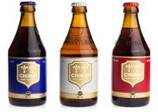 Пиво бутылок Chimay голубых, белых и красных Стоковые Фотографии RF