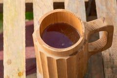 Пиво в деревянной кружке Стоковое фото RF