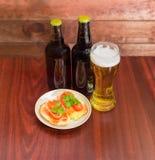 Пиво и сандвичи лагера с посоленной форелью Стоковая Фотография