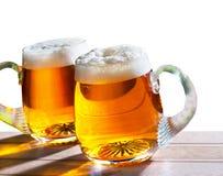 Пиво на белой предпосылке Стоковое Изображение