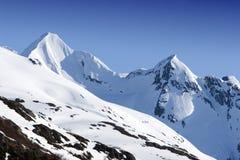 пики горы снежные стоковая фотография