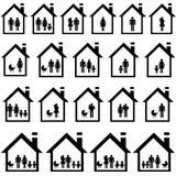 Пиктограммы семей в домах Стоковые Изображения RF
