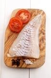 Пикши fillet на деревянной доске Стоковое фото RF