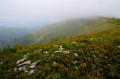 Пик горы в облаках Стоковые Фото