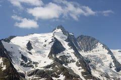 Пик горы Grossglocker с снегом в временени Стоковые Изображения