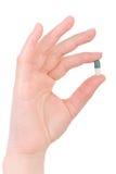 пилюлька удерживания руки капсулы Стоковое Фото