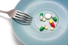 пилюльки еды Стоковое фото RF