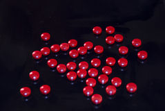 пилюльки кофеина красные Стоковая Фотография