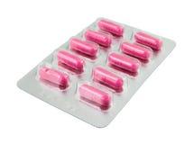 пилюльки пакета pink белизна Стоковые Фото