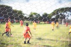 Пинать футбол Стоковое фото RF