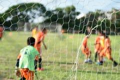 Пинать футбол Стоковое Изображение RF