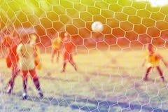 Пинать футбол Стоковые Изображения