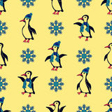 Пингвины одетые в шляпах и шарфах зимы Стоковые Фотографии RF