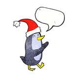 пингвин рождества шаржа с пузырем речи Стоковое Изображение
