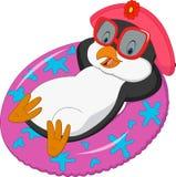 Пингвин шаржа женский ослабляя на раздувном кольце Стоковые Фото