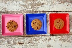 Пинк, синь и красная площадь с плитами с печеньями Стоковое Изображение RF