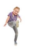 Пинок маленькой девочки ногой Стоковая Фотография RF