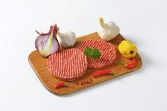 пирожки гамбургера сырцовые Стоковая Фотография RF