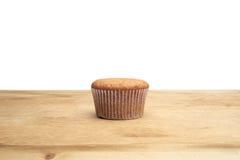 3 пирожного на деревянном столе Стоковые Фотографии RF