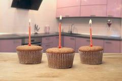 3 пирожного с свечами Стоковое Изображение RF