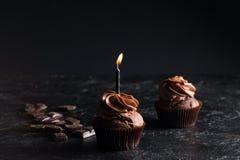 Пирожное шоколада с свечой Стоковое Изображение RF