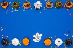 Пирожные и конфеты хеллоуина Стоковые Изображения